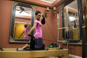 Pilates of Jackson owner Angelia Brown demonstrates an exercise in the private room.