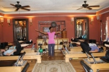 Pilates of Jackson owner Angelia Brown instructs a class.