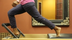Angelia Brown of Pilates of Jackson demonstrates pilate move.
