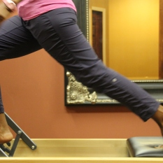 Angelia Brown of Pilates of Jackson demonstrates pilate move.